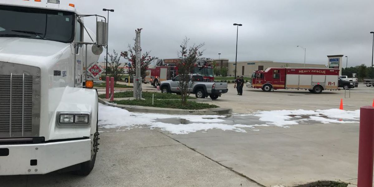 Car runs over hose at gas station, spills gas
