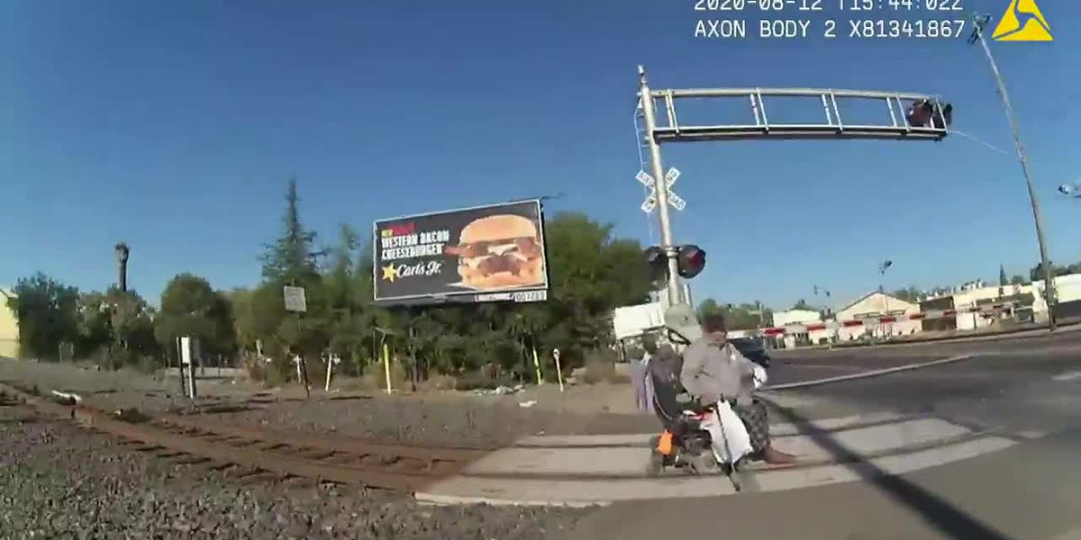 CAUGHT ON CAMERA: Officer saves man stuck on railroad track