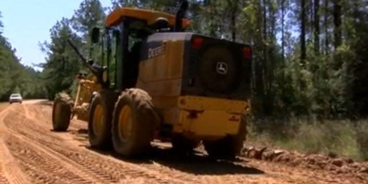 Crews working to make storm-damaged road passable