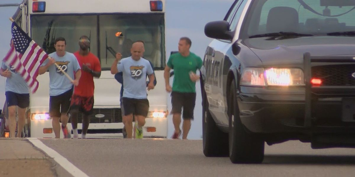 SWAR officers carry Flame of Hope to help Special Olympics