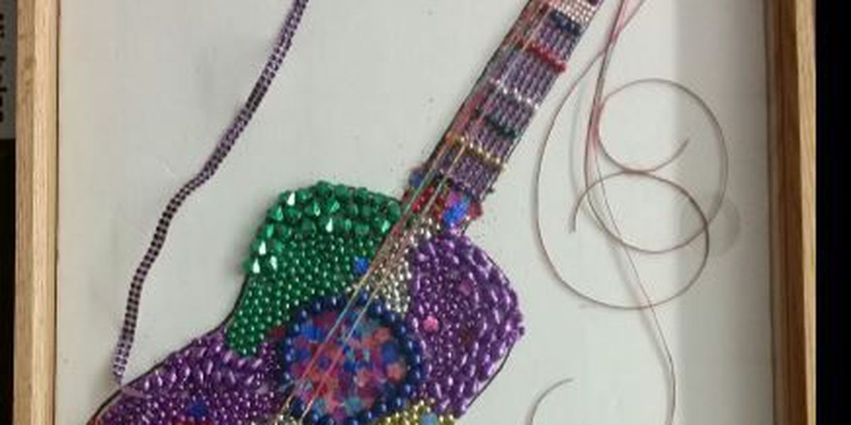 Local students with autism make Mardi Gras guitar for Taylor Swift