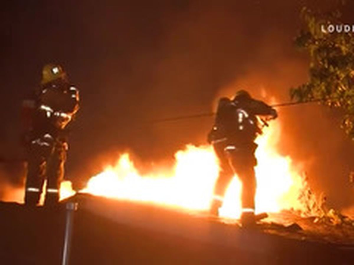 Firefighter falls off roof while battling flames