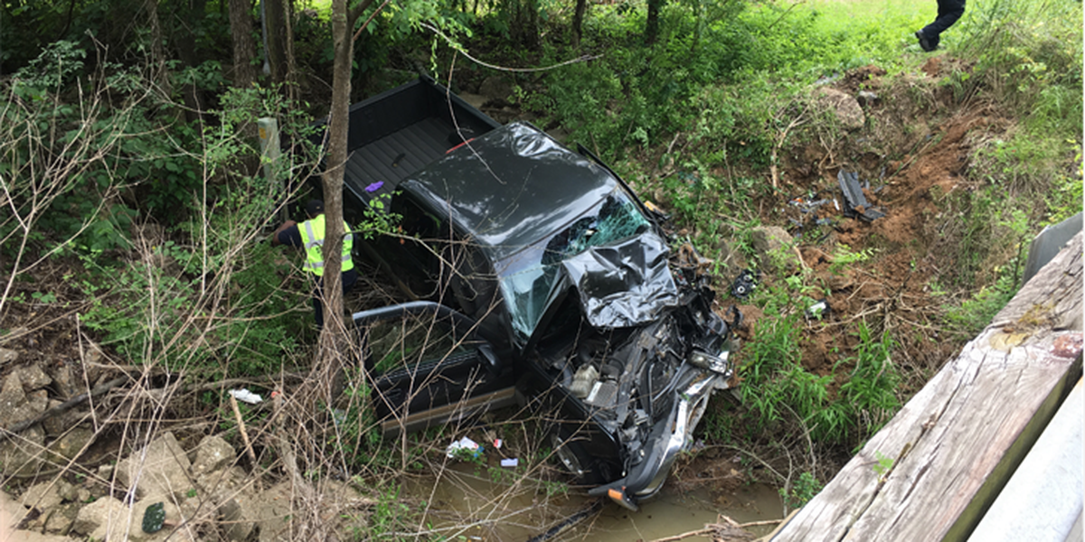 Man hospitalized after truck goes over guardrail, into ditch