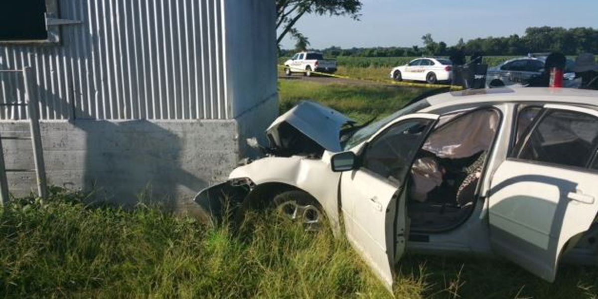 Woman dead after crashing into building
