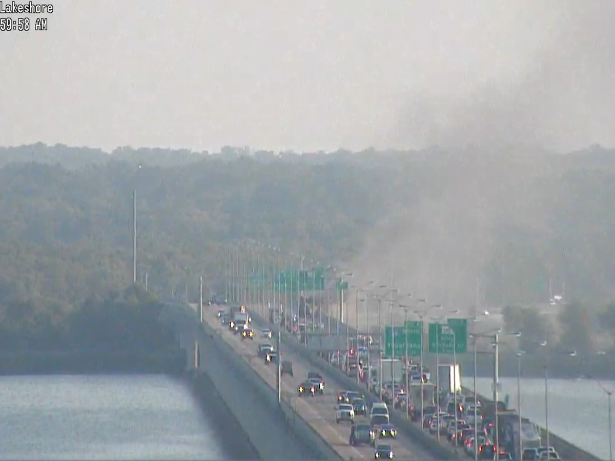 Vehicle fire stalls traffic on Cross Lake Bridge