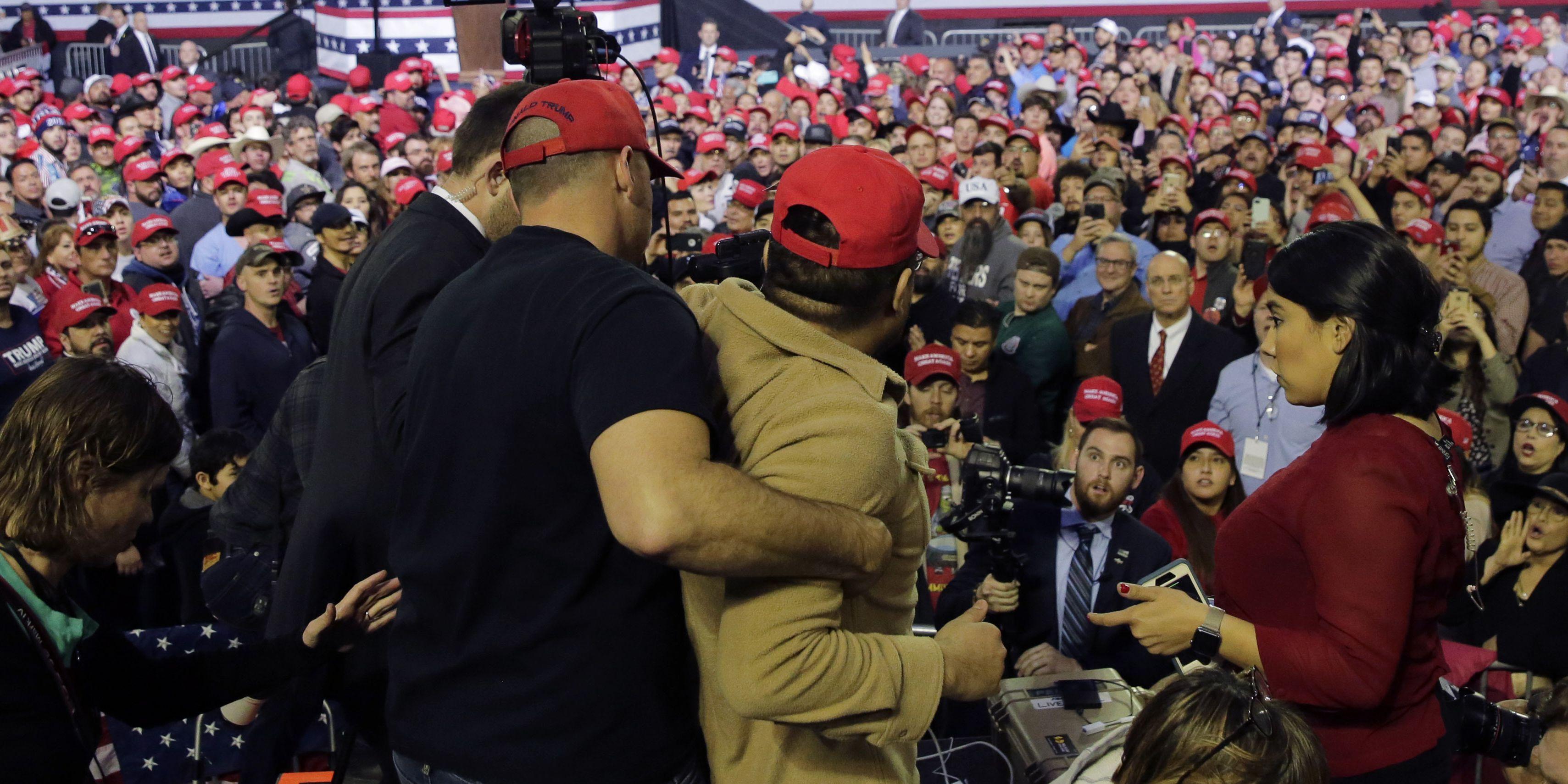 Man at Trump rally attacks BBC cameraman