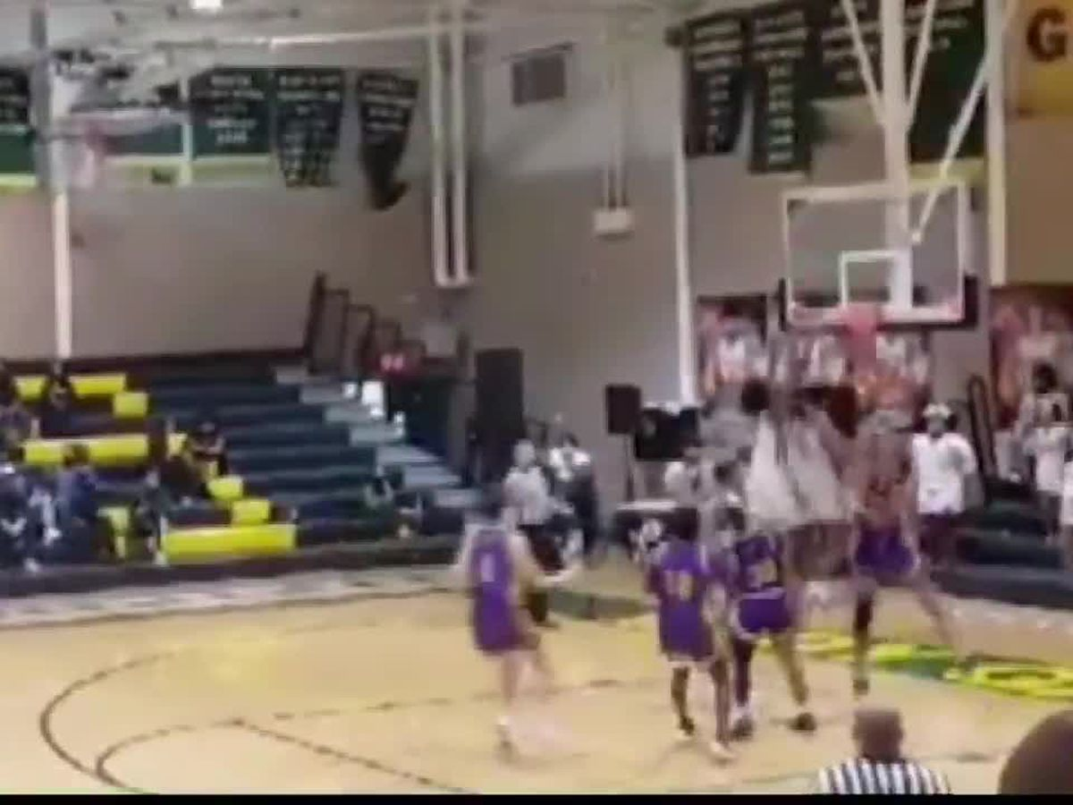 Caught on camera: Watch as a high school basketball game comes to a shattering end in the third quarter