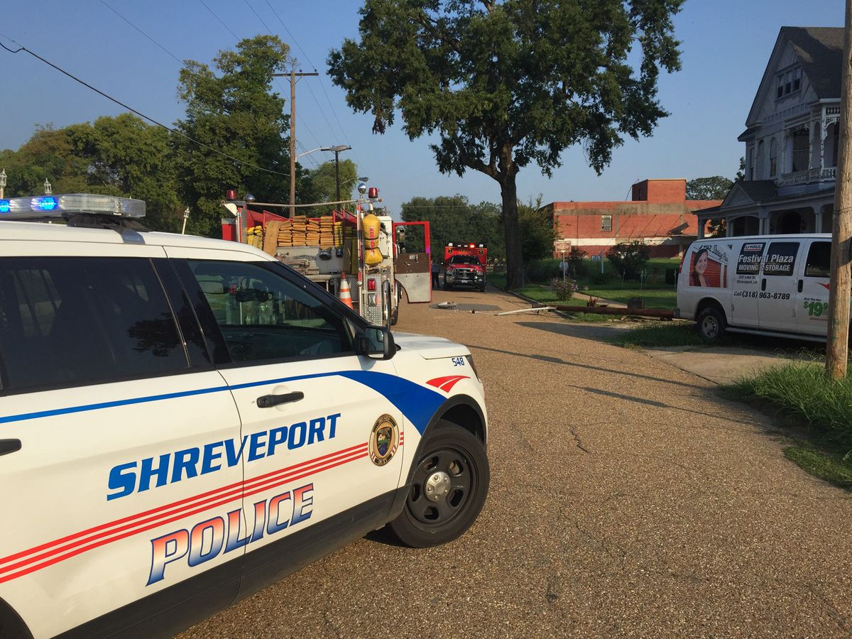Man hits utility pole in moving van, another sent to hospital