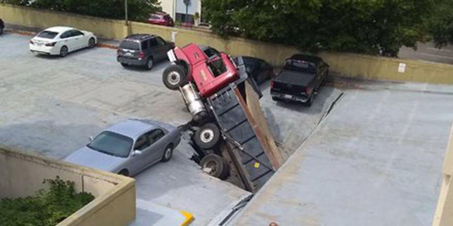 Driver blames GPS after dump truck falls through parking deck in Boston