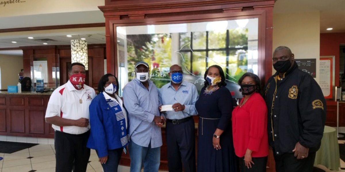 ArkLaTex fraternities and sororities present check to evacuee fund