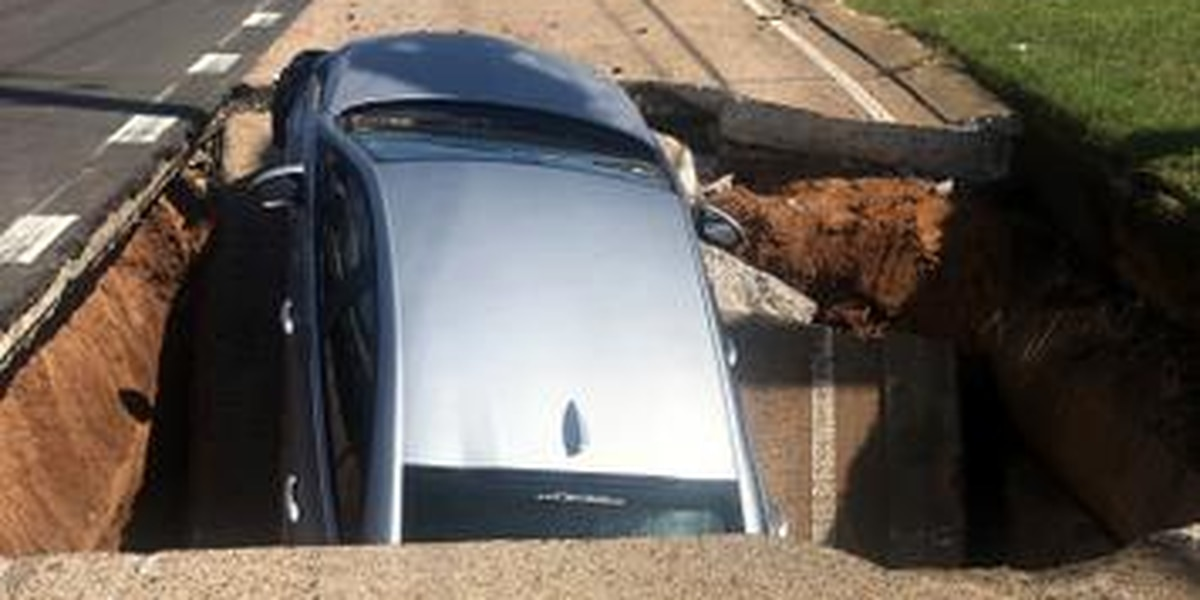 Major Bossier City roadway opens up, swallows car