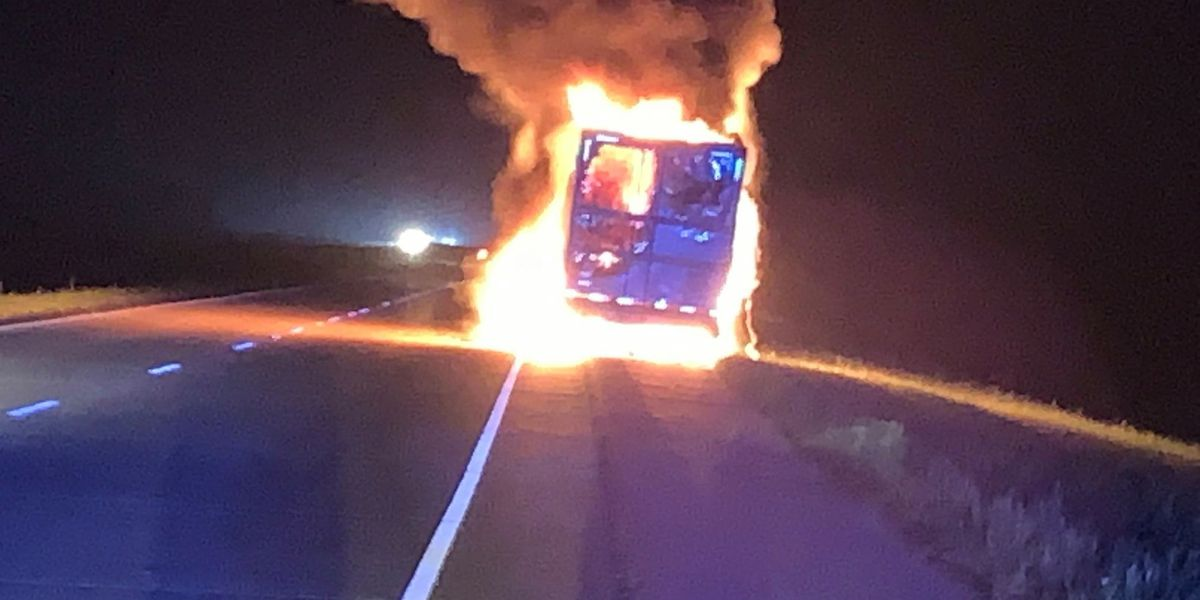 18-wheeler engulfed in flames; cargo determined total loss