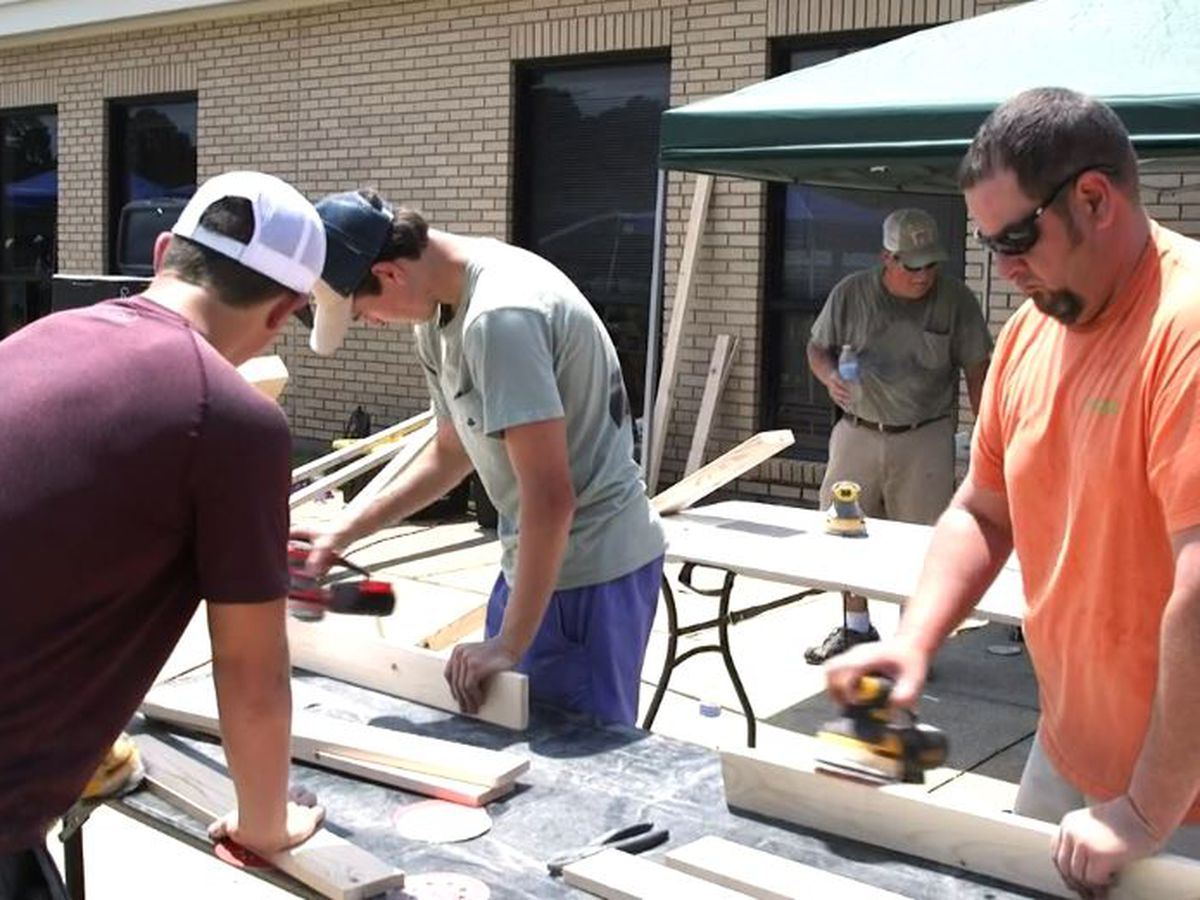 Volunteers stay after church to build beds for children
