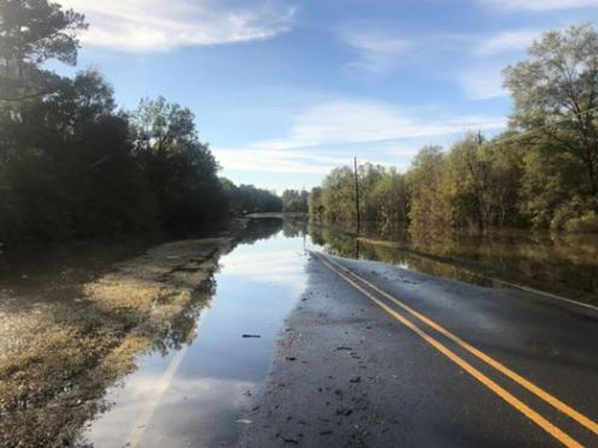 Flooded road now open, but high water remains