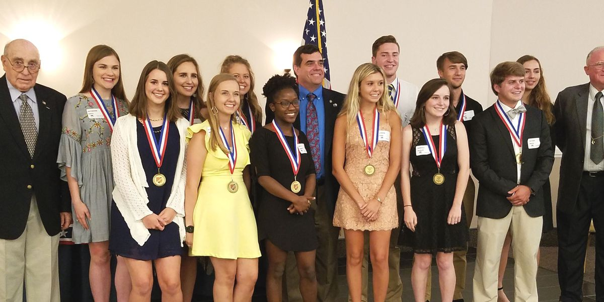 Veterans group presents $26K in scholarships to 19 students