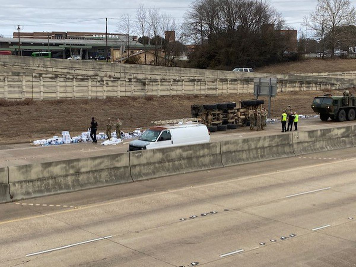 Truck hauling water overturns; one lane of I-20 West open