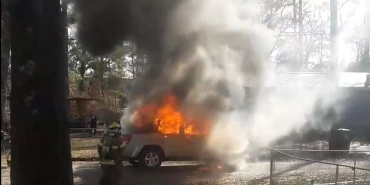 RAW VIDEO: SUV catches fire; woman, 2 kids get out safely
