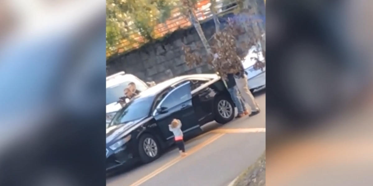 Video shows barefoot toddler with hands up walking toward armed police officers
