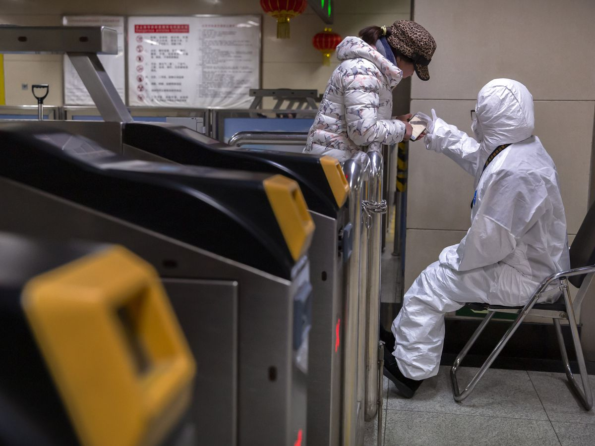 China building a hospital to treat coronavirus, expands lockdowns