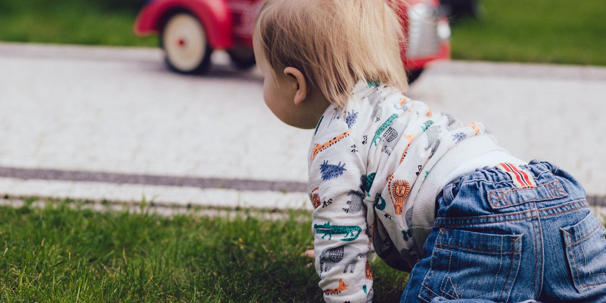 Man finds baby crawling across busy street