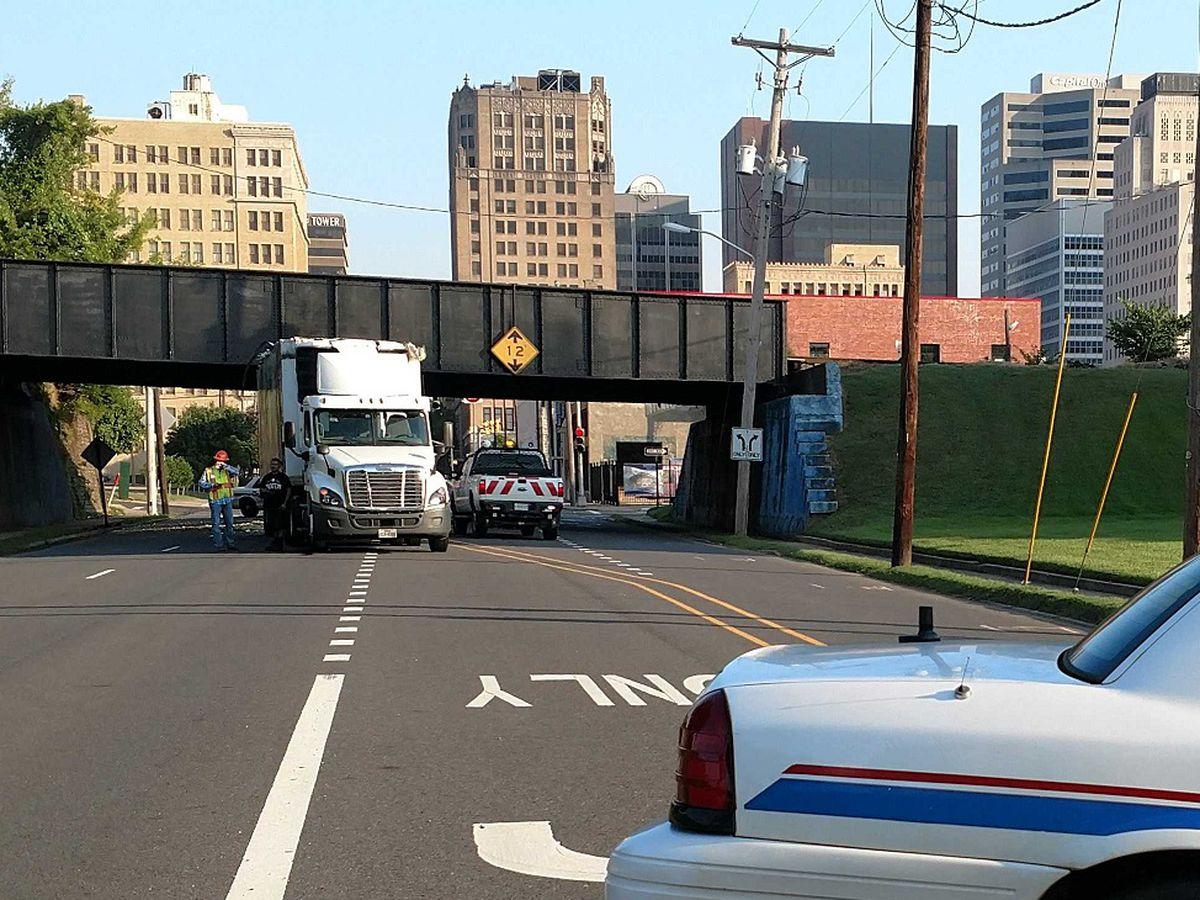 Tractor-trailer stuck under railroad bridge near downtown