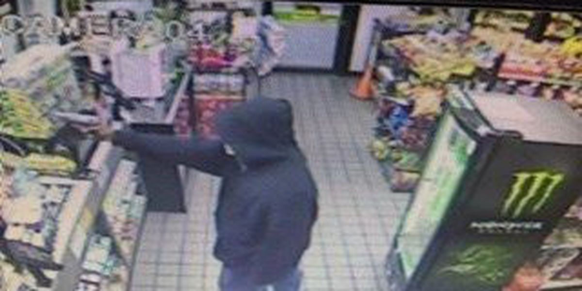 SPD search for gunman in Exxon robbery