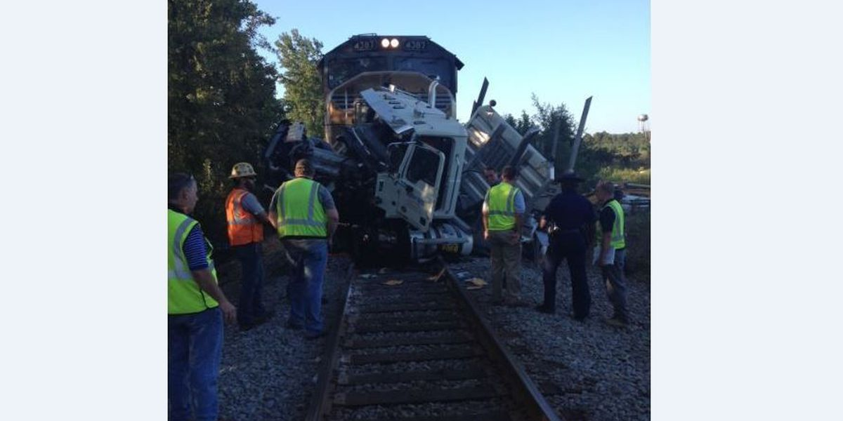 Troopers ID log truck driver killed in accident involving train
