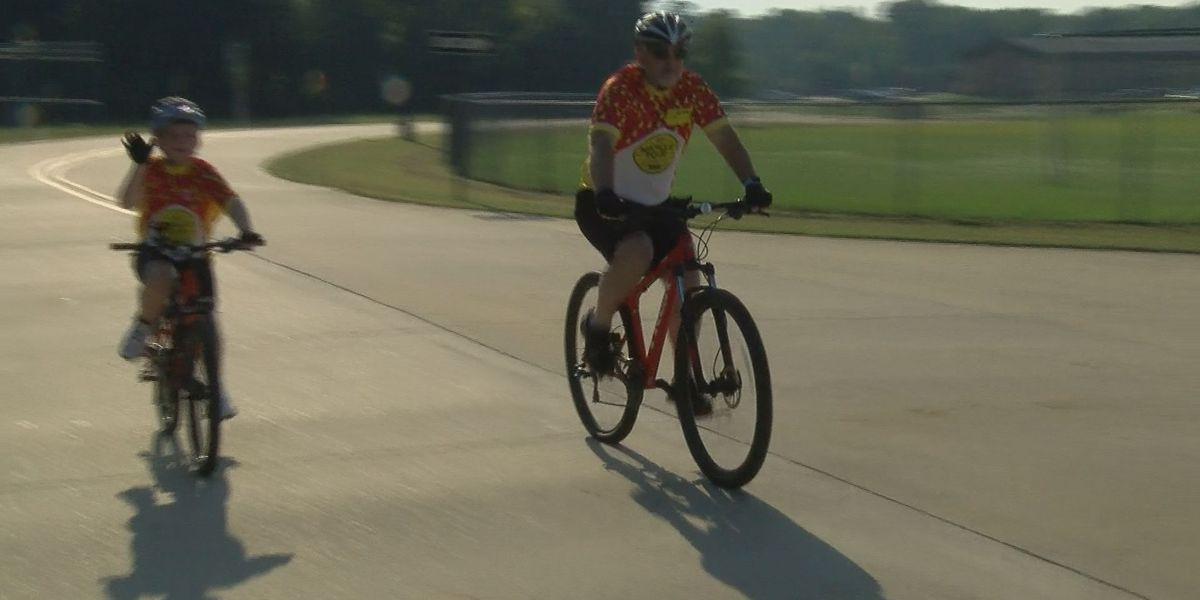 Father and son bond while biking to help area children