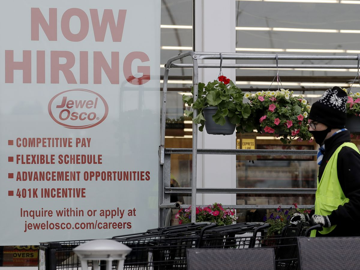 Gripped by surging pandemic, US employers cut back on hiring