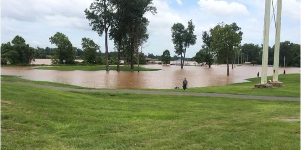 Red River crest forecast raised as residents fish floodwaters