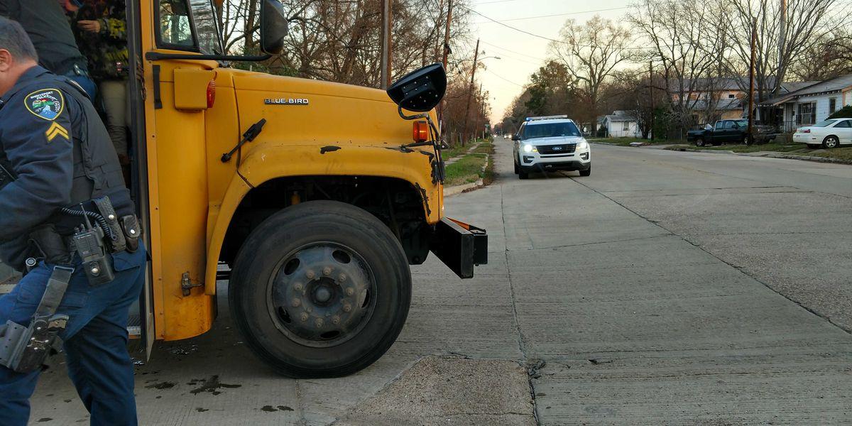 SUV clips front bumper of Caddo Parish school bus