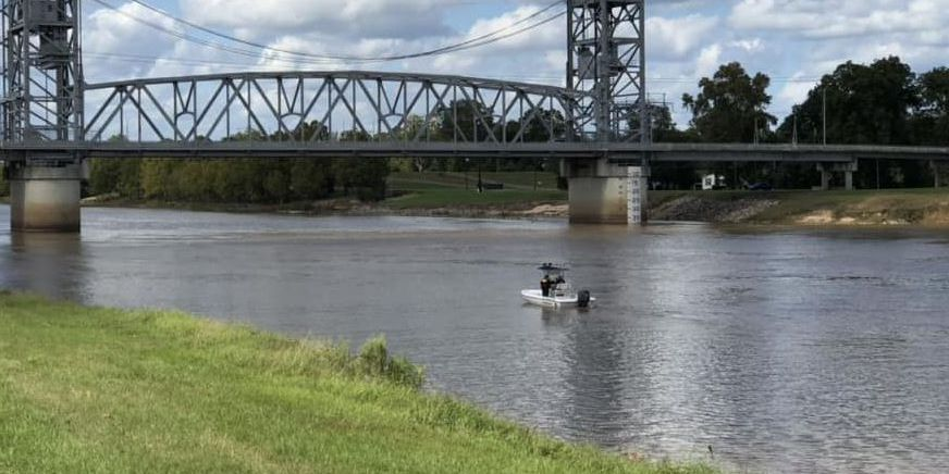 Searchers look for woman who might have jumped into river