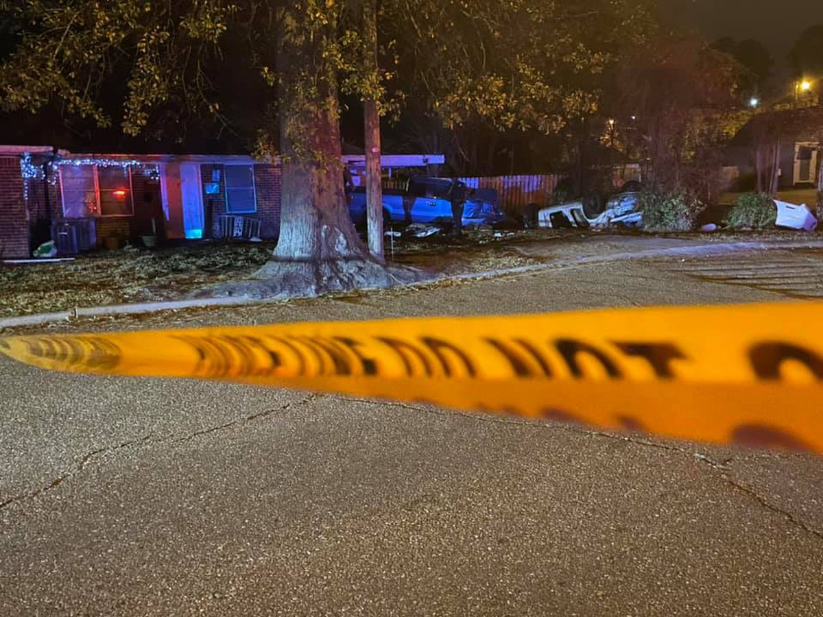 Car crashes into house; one person dead