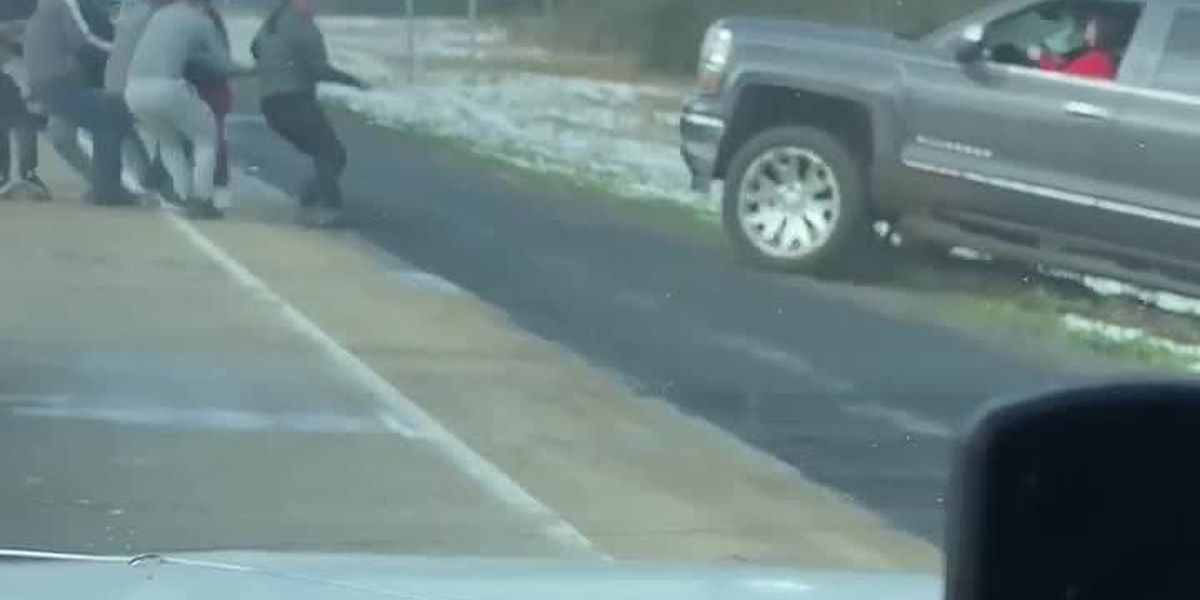 VIEWER VIDEO: Group of men help pull woman's truck out of ditch