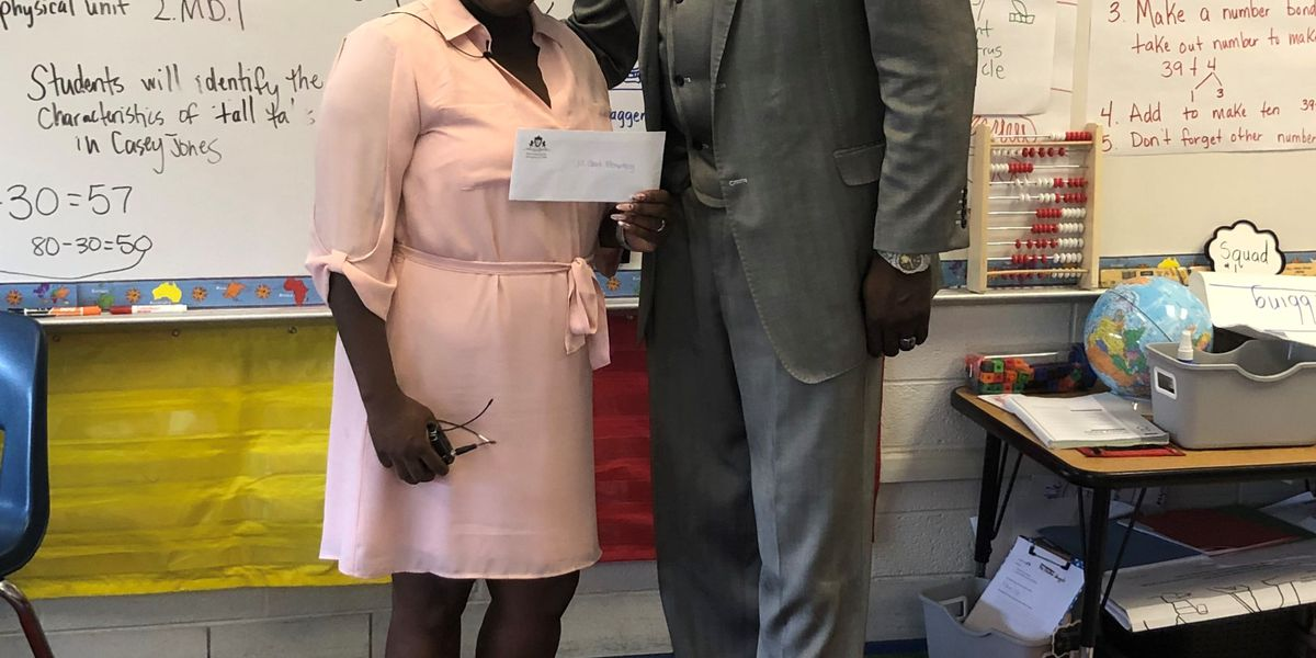 Mortuary presents first three $1,000 gifts to schools