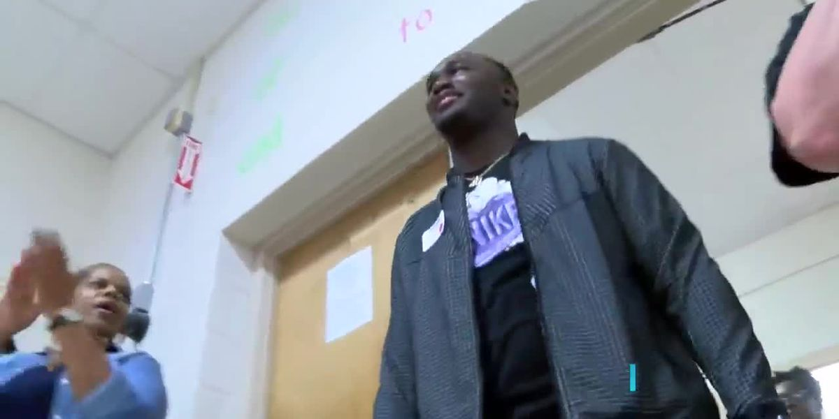 LSU football star and Springhill native Devin White visits with youths at J.L. Jones Elementary in Minden