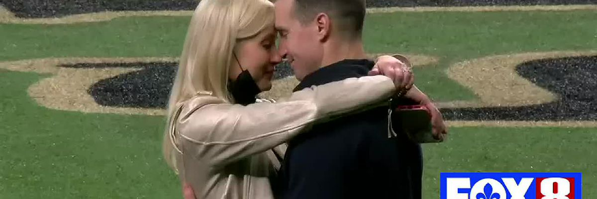 Brittany and Drew Brees embrace postgame
