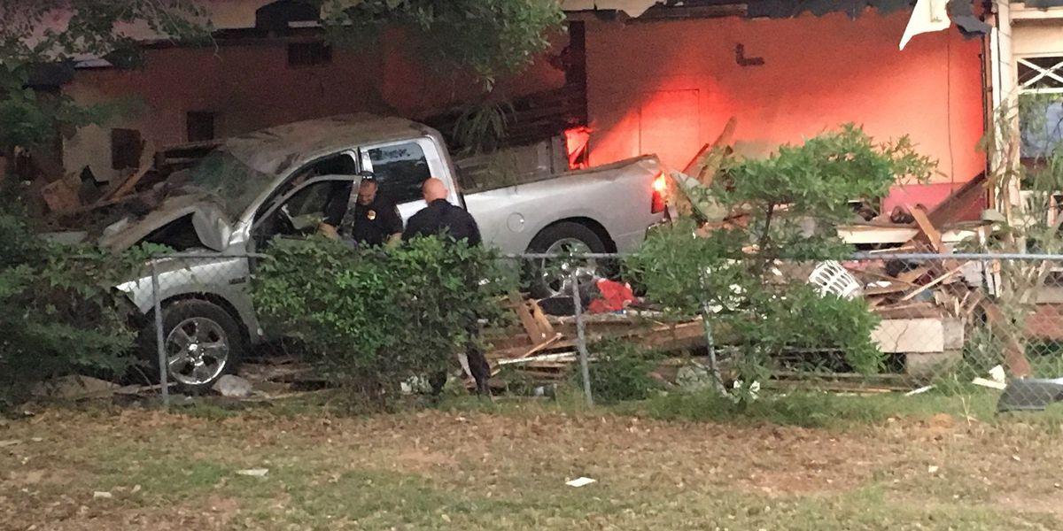 Truck fleeing police runs through house; driver, resident hurt