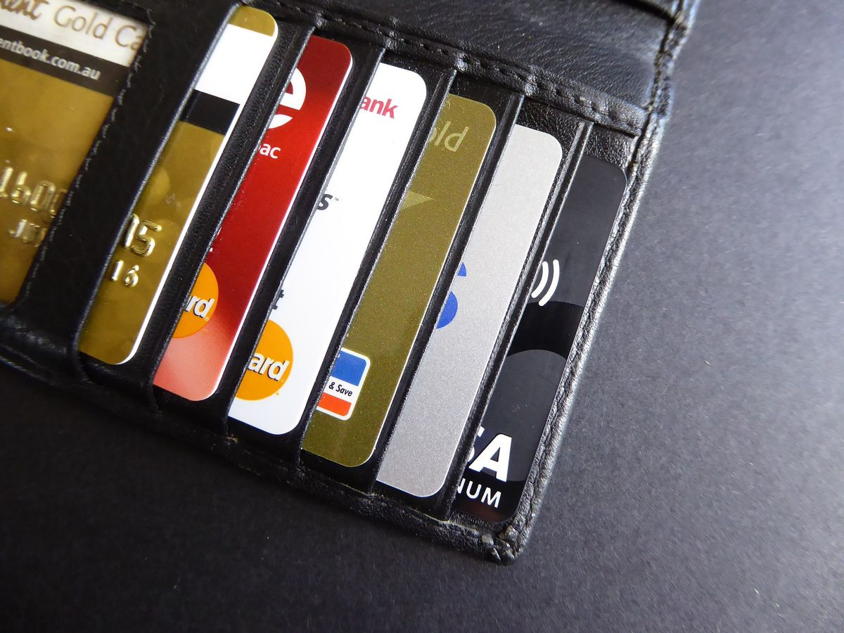 Two men arrested for ATM fraud; found with multiple credit cards and thousands in cash