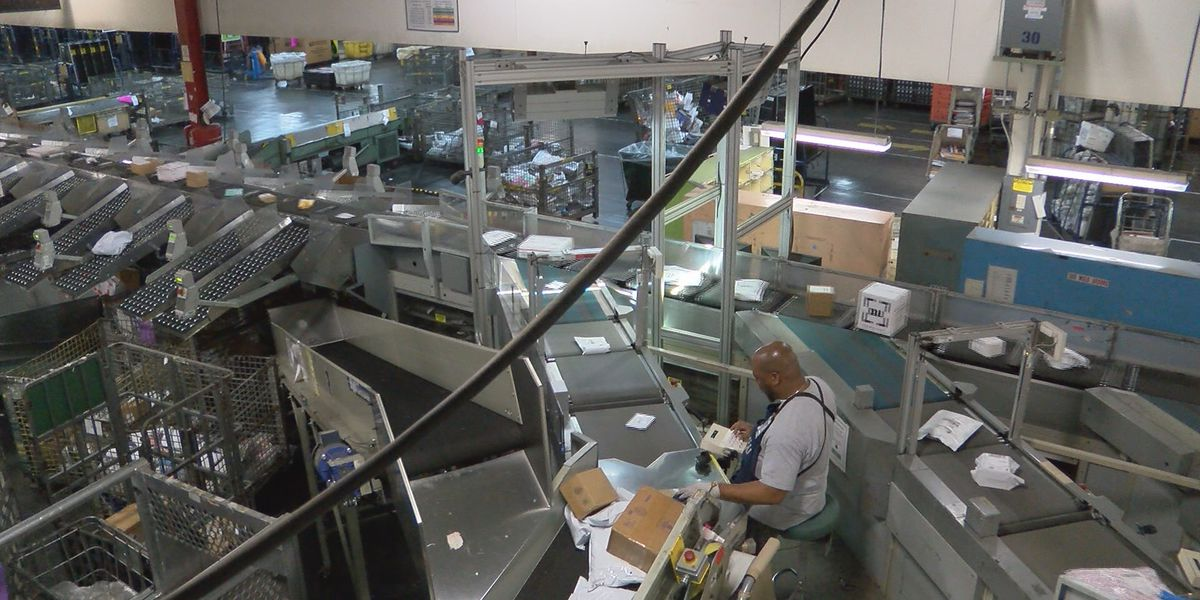 Holiday shipping magic at work in USPS mail-processing center