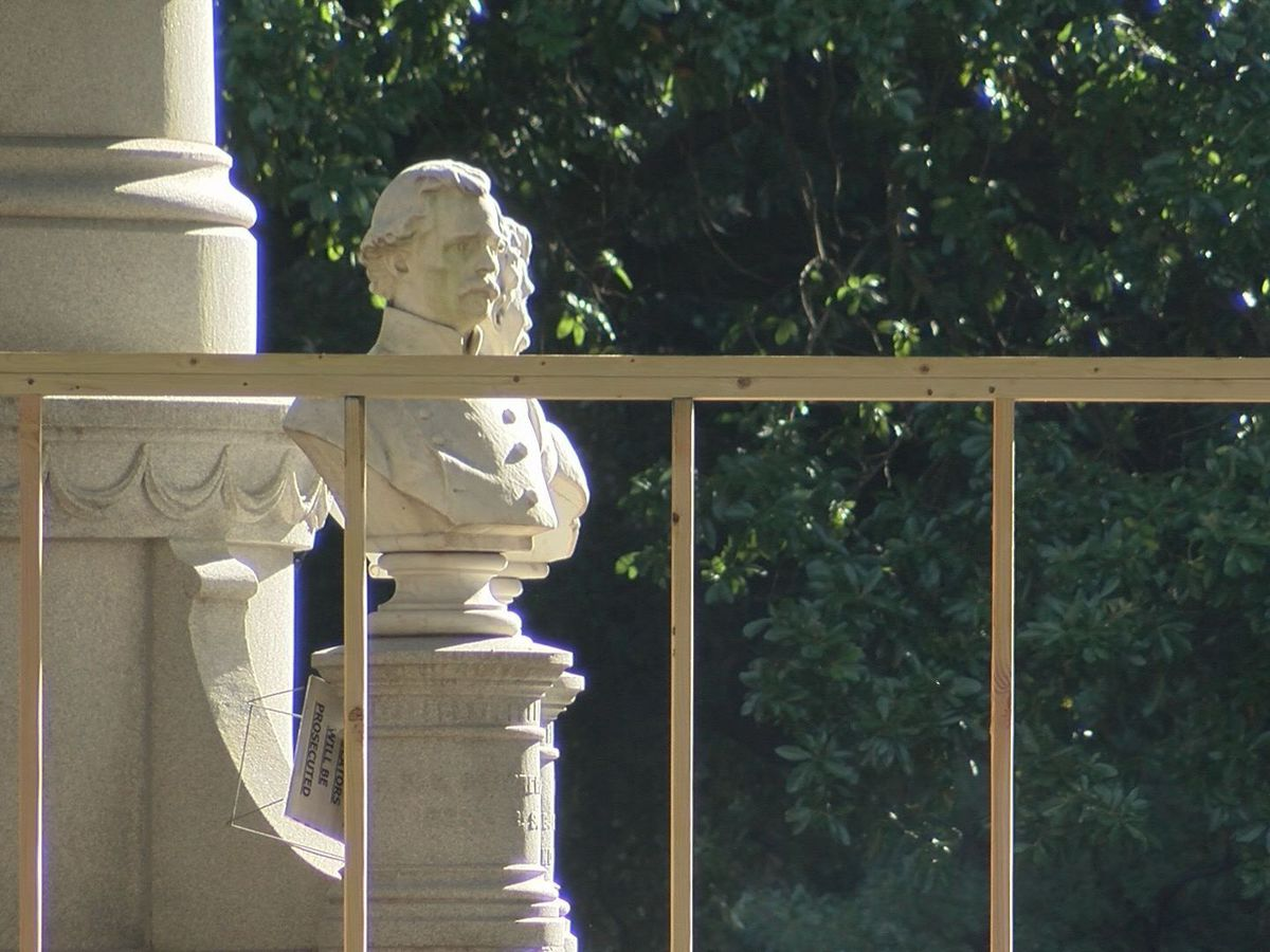 Workers building box around Caddo Confederate monument