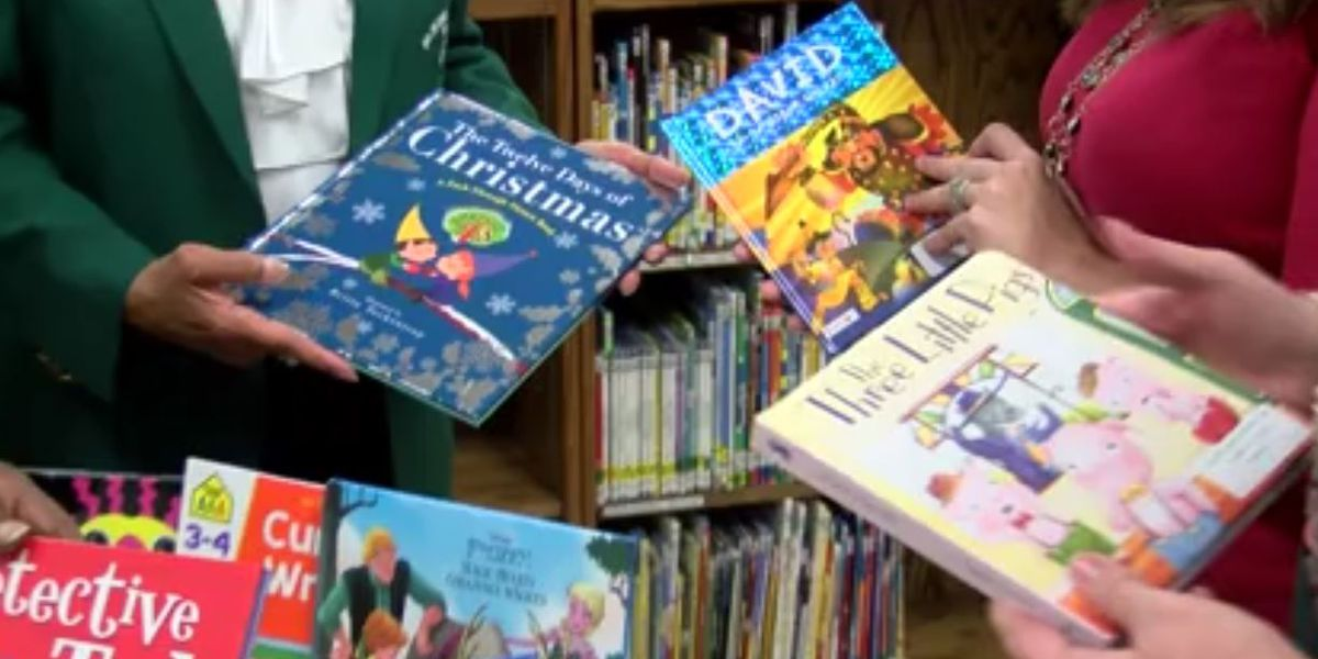 Sorority shares the gift of reading, donates books to school
