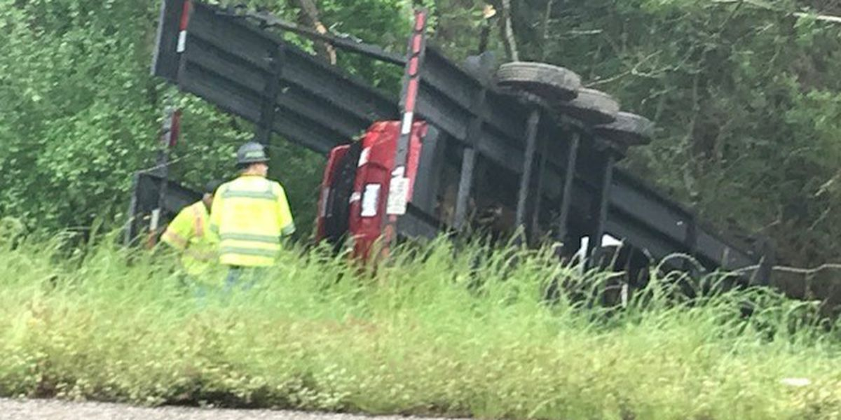 Fully loaded car hauler overturns after hydroplaning in Rusk County