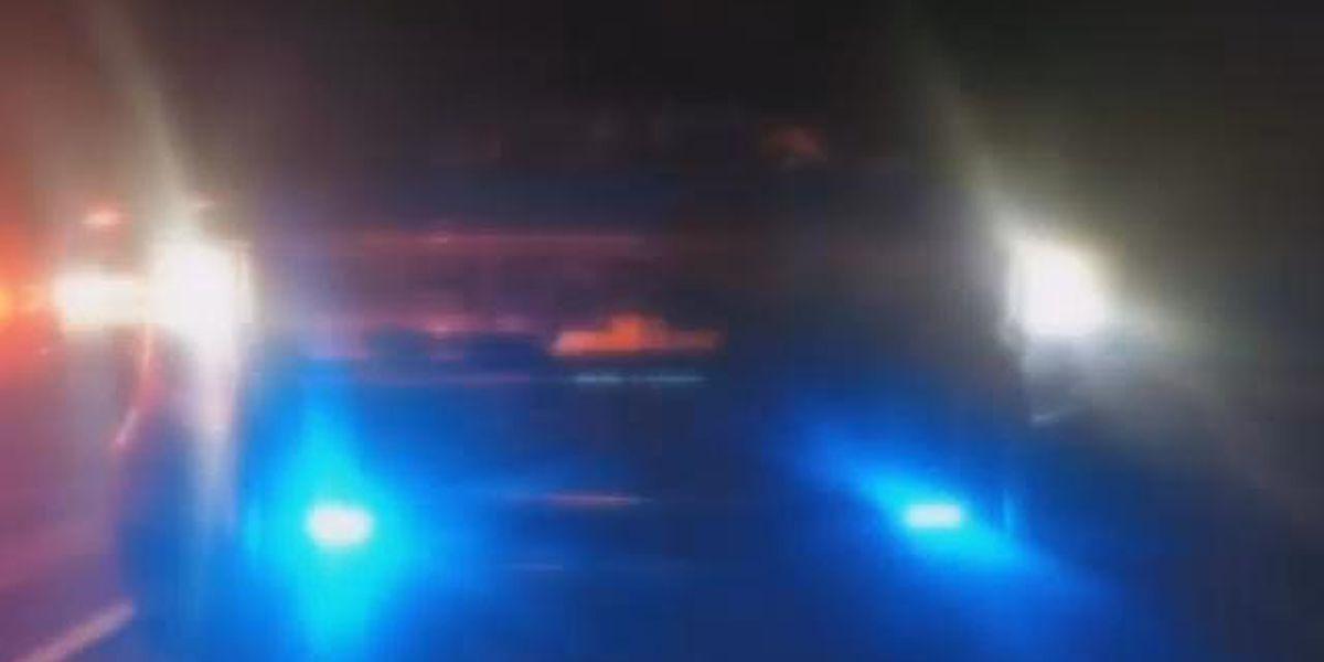 Woman's throat cut; man taken into custody