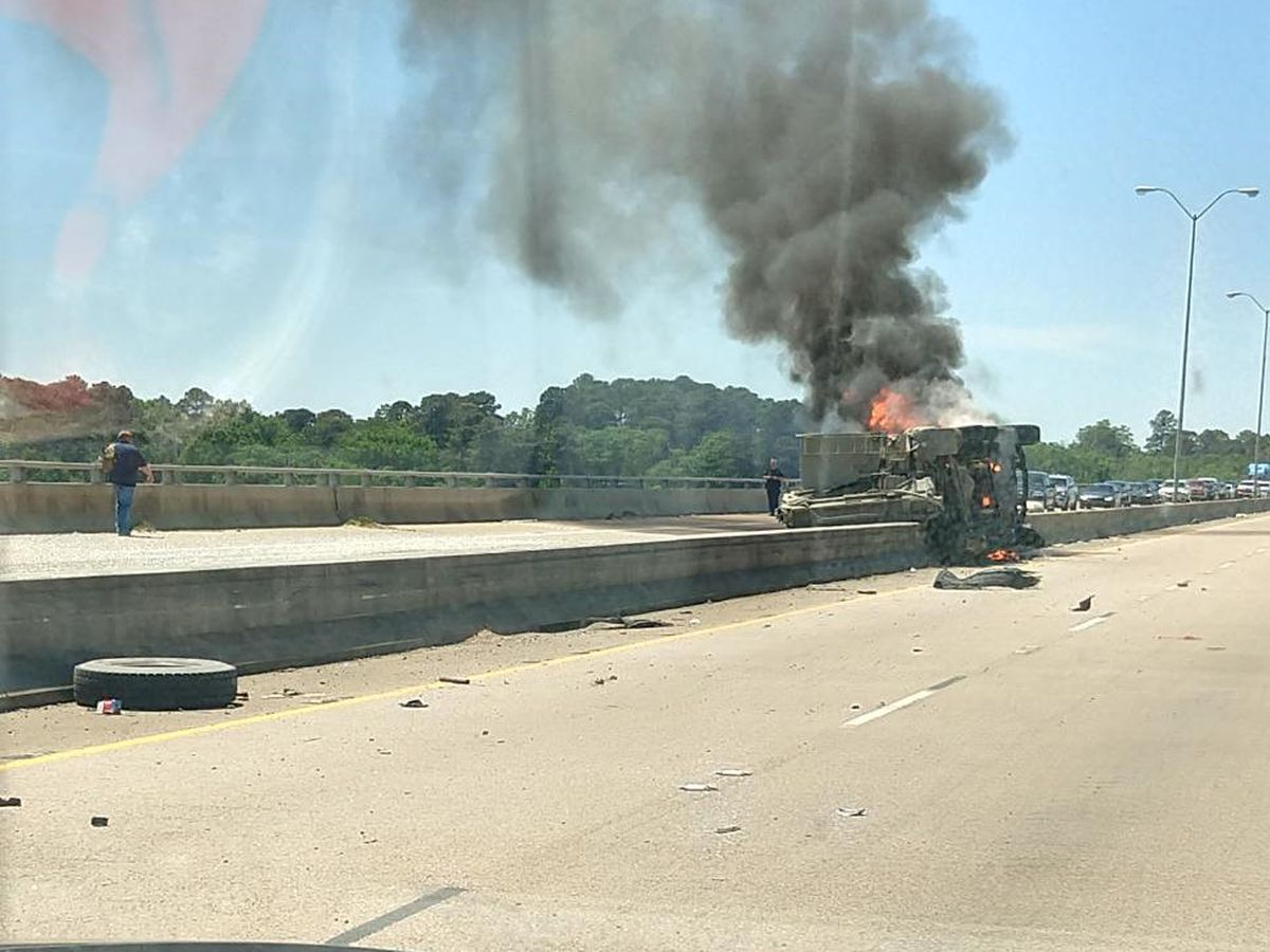 Overturned dump truck catches fire on Cross Lake Bridge
