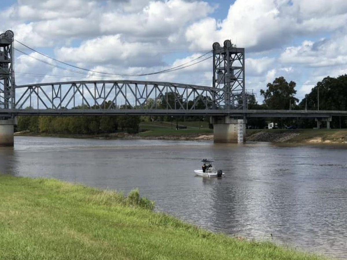 Searchers look for woman who might have jumped into river, find man's body