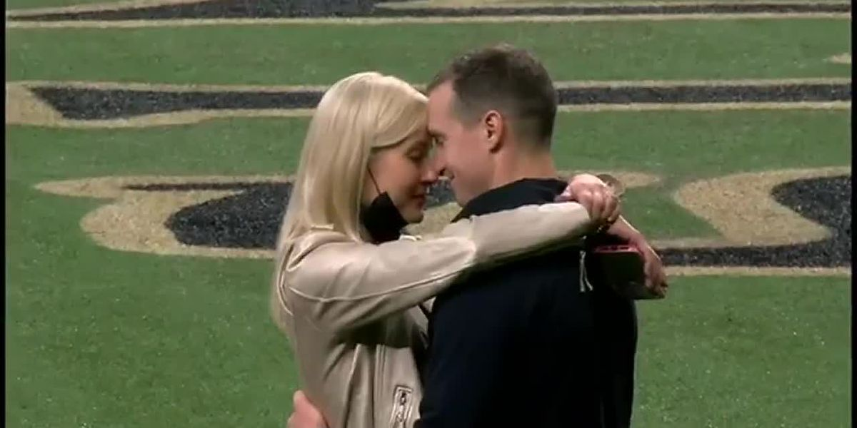Brees takes a moment on field with family, Brady